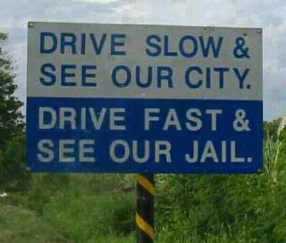 82e6ddcea7e1ff2b694c2421cf410391-drive-slow-sign